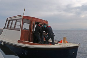 Crew of Swedish coastal patrol boat KBV 477 arresting suspected people smuggler off Lesbos